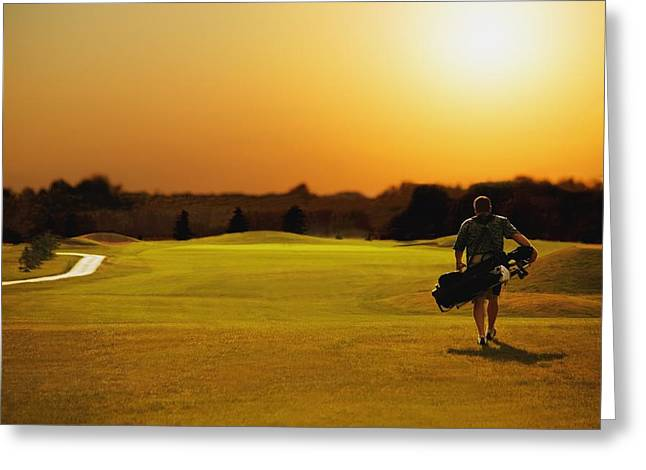 Male To Male Greeting Cards - Golfer Walking On A Golf Course Greeting Card by Darren Greenwood