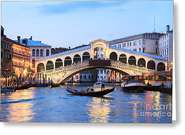 Iconic Places Greeting Cards - Gondola in front of Rialto bridge at dusk Venice Italy Greeting Card by Matteo Colombo