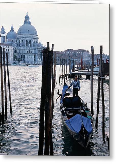 Occupation Greeting Cards - Gondolier In A Gondola With A Cathedral Greeting Card by Panoramic Images