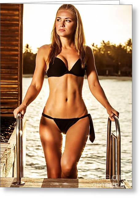Swimsuit Photo Greeting Cards - Gorgeous female in sunset light Greeting Card by Anna Omelchenko