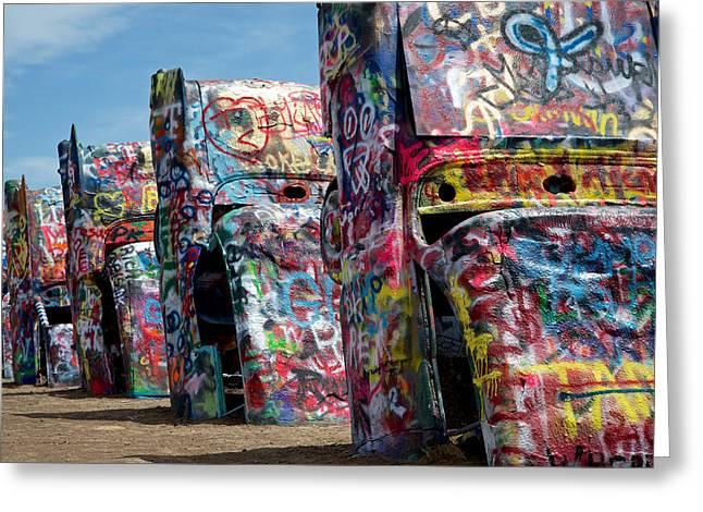 Graffiti At The Cadillac Ranch Amarillo Texas Greeting Card by Mary Lee Dereske