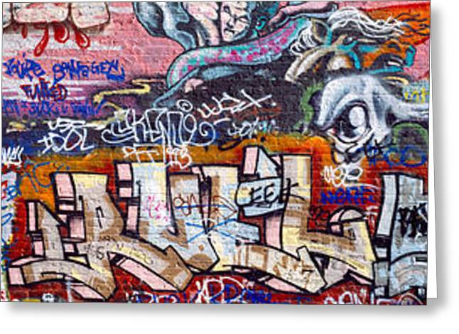 Painted Walls Greeting Cards - Graffiti On City Wall Greeting Card by Panoramic Images