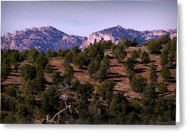 Prescott Greeting Cards - Granite Mountain Beyond the Pinon and Juniper Hillside Greeting Card by Aaron Burrows