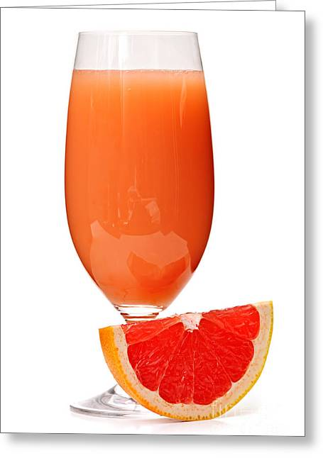 Goblet Greeting Cards - Grapefruit juice in glass Greeting Card by Elena Elisseeva