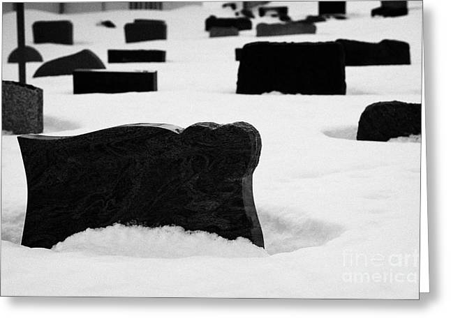 Headstones Greeting Cards - gravestones partially buried in the snow in the cemetery outside Honningsvag kirke church Greeting Card by Joe Fox