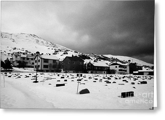 Headstones Greeting Cards - gravestones partially buried in the snow in the cemetery outside Honningsvag kirke church norway Greeting Card by Joe Fox