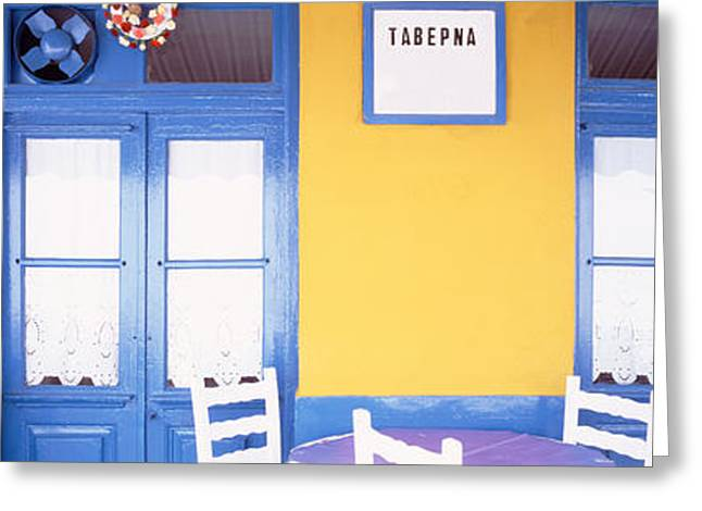 Empty Chairs Greeting Cards - Greece, Hydra, Empty Restaurant Greeting Card by Panoramic Images