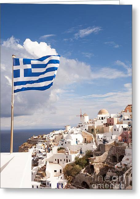 Greek Icon Greeting Cards - Greek flag waving on Oia - Santorini - Greece Greeting Card by Matteo Colombo