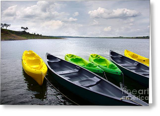 Canoeing Photographs Greeting Cards - Green and yellow kayaks Greeting Card by Carlos Caetano
