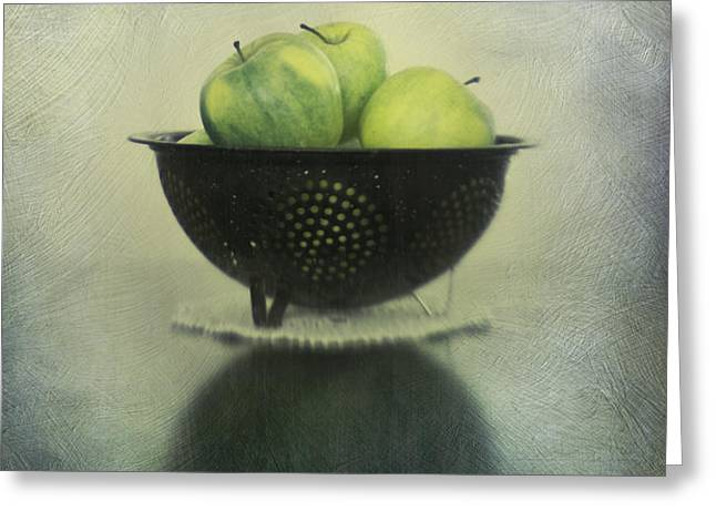 Green apples in an old enamel colander Greeting Card by Priska Wettstein