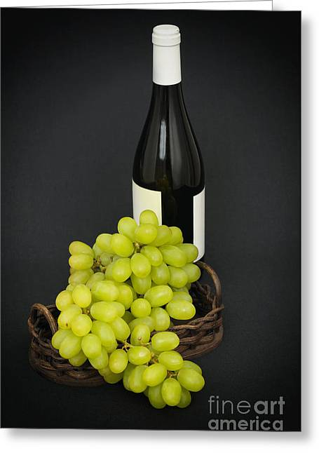 Bunch Of Grapes Greeting Cards - Green grapes and a bottle of wine on black Greeting Card by Skyfish Images