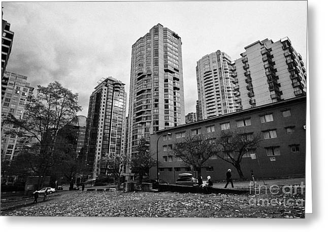 green space in front of high rise apartment condo blocks in the west end between robson and west geo Greeting Card by Joe Fox
