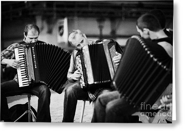 Polish City Greeting Cards - Group Of Accordion Players Perform In The Street In Rynek Glowny Town Square Krakow Greeting Card by Joe Fox