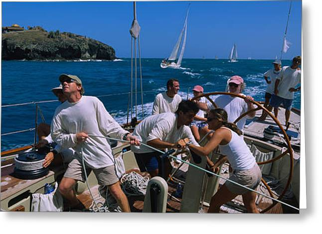 Water Vessels Greeting Cards - Group Of People Racing In A Sailboat Greeting Card by Panoramic Images