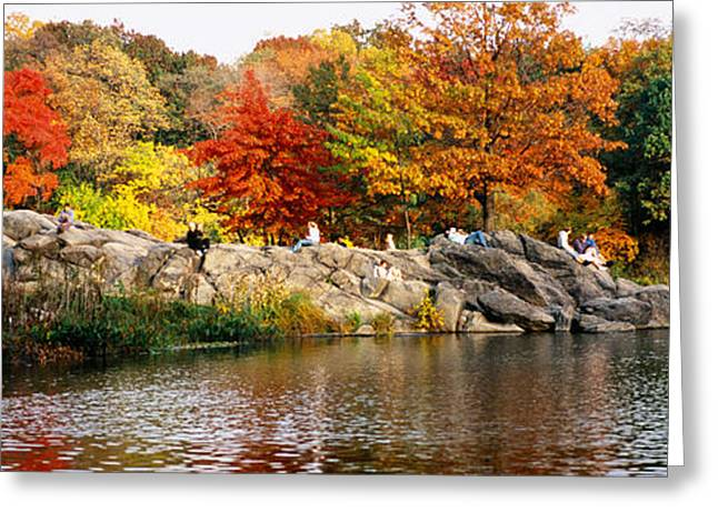 Colors Of Autumn Greeting Cards - Group Of People Sitting On Rocks Greeting Card by Panoramic Images