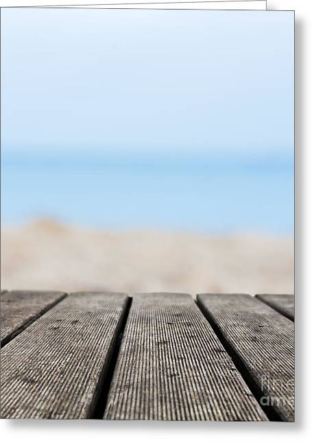 Sea Platform Greeting Cards - Grunge rustic real wood boards on the beach shore Greeting Card by Michal Bednarek
