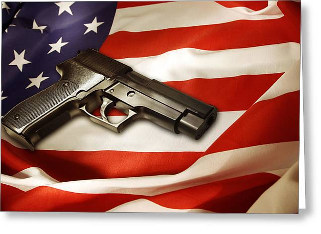 Democratic Greeting Cards - Gun on flag Greeting Card by Les Cunliffe