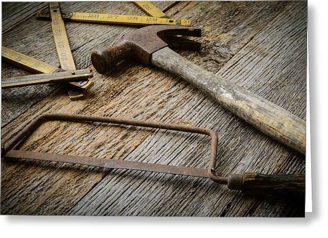 Yellow Hammer Greeting Cards - Hammer Saw and Measuring Tape on Rustic Wood Background Greeting Card by Brandon Bourdages