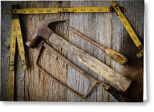 Yellow Hammer Greeting Cards - Hammer Saw Screwdriver and Measuring Tape on Rustic Wood Backg Greeting Card by Brandon Bourdages