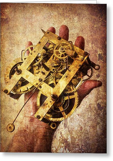 Repaired Greeting Cards - Hand Holding Clock Gears Greeting Card by Garry Gay