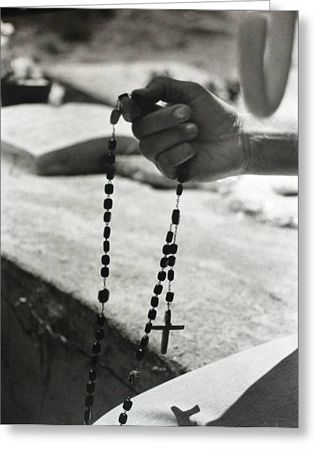Praying Hands Greeting Cards - Hand Holding Rosary Greeting Card by Nubia Galvan