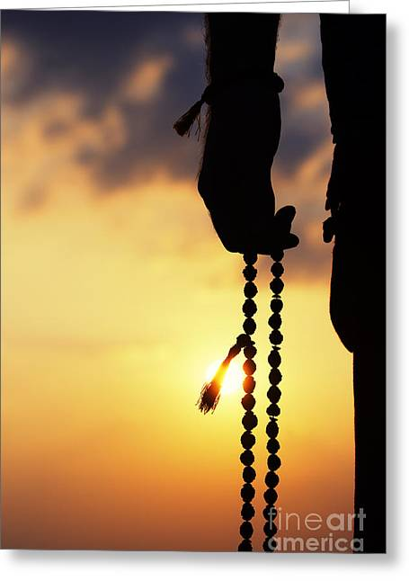 Praying Hands Photographs Greeting Cards - Hand holding Rudraksha beads Greeting Card by Tim Gainey