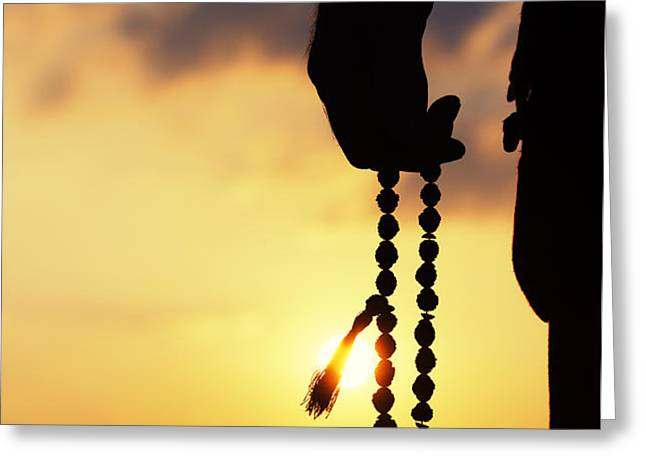 Hand holding Rudraksha beads Greeting Card by Tim Gainey