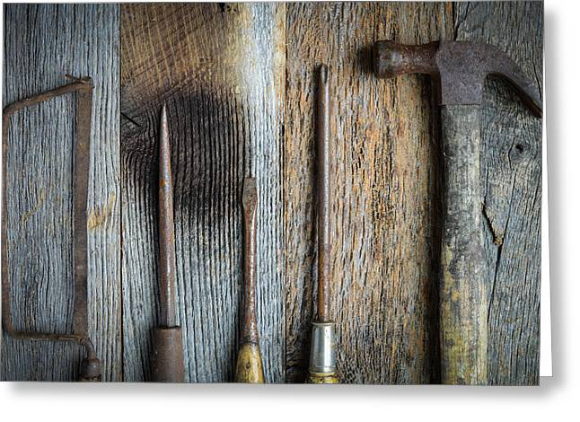Tighten Greeting Cards - Hand Saw Hammer and Screwdrivers on Rustic Wood Background Greeting Card by Brandon Bourdages