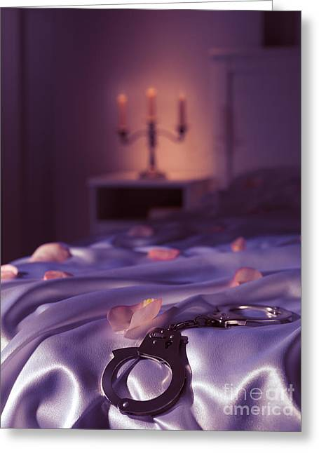 Bdsm Greeting Cards - Handcuffs and rose petals on bed Greeting Card by Oleksiy Maksymenko
