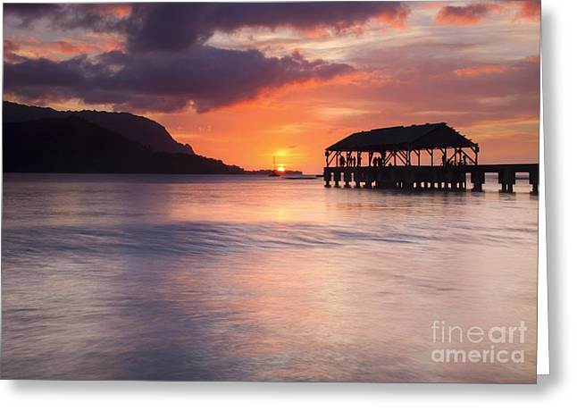 Hanelei Pier Sunset Greeting Card by Mike Dawson