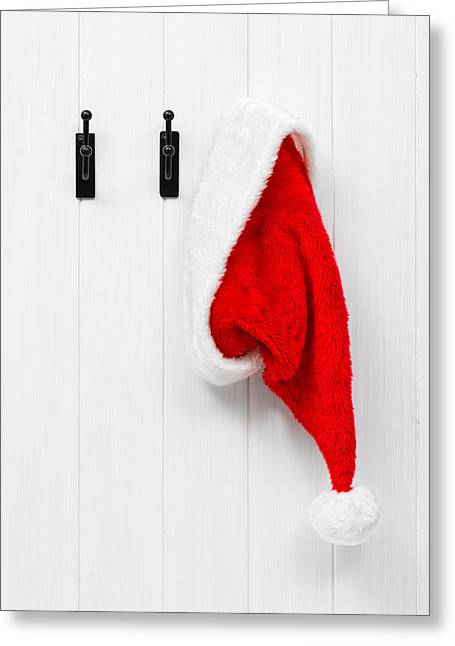 Nicholas Greeting Cards - Hanging Santa Hat Greeting Card by Amanda And Christopher Elwell