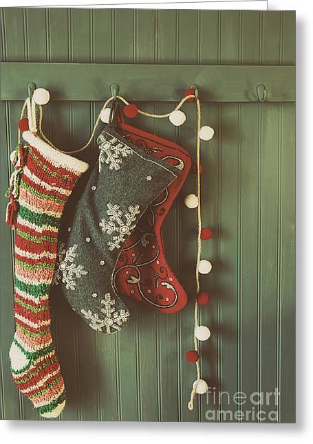 Coat Rack Greeting Cards - Hanging stockings ready for Christmas Greeting Card by Sandra Cunningham