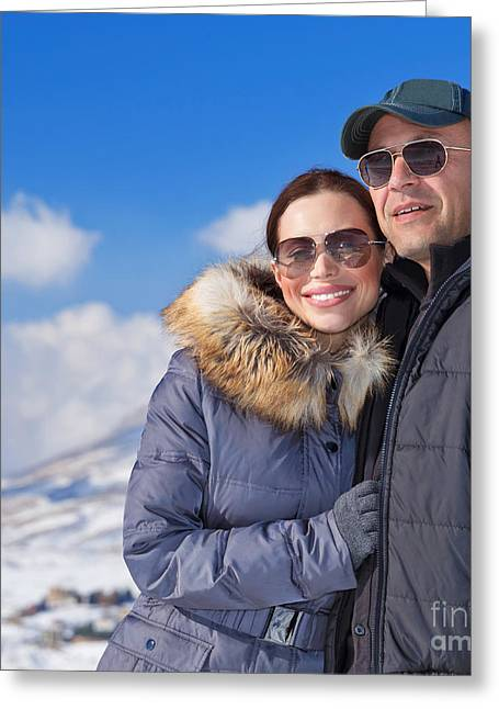 Snowy Day Greeting Cards - Happy couple in winter mountains Greeting Card by Anna Omelchenko