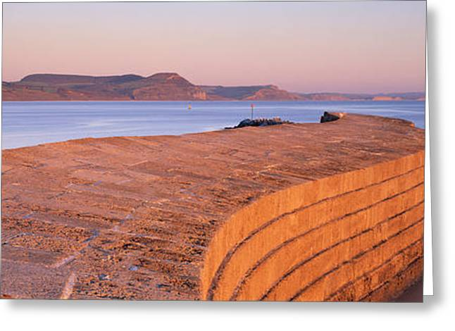 Cobb Greeting Cards - Harbour Wall At Dusk, The Cobb, Lyme Greeting Card by Panoramic Images