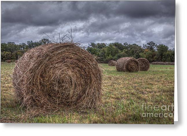 Haybale Greeting Cards - Hay bale with Clouds  Greeting Card by Larry Braun