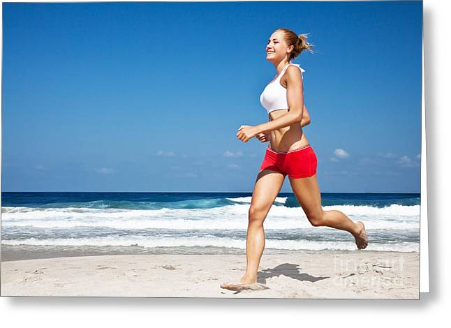 Jogging Greeting Cards - Healthy woman running on the beach Greeting Card by Anna Omelchenko