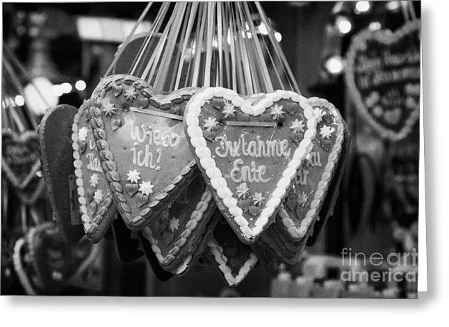 Berlin Germany Greeting Cards - heart shaped Lebkuchen hanging on a christmas market stall in Berlin Germany Greeting Card by Joe Fox