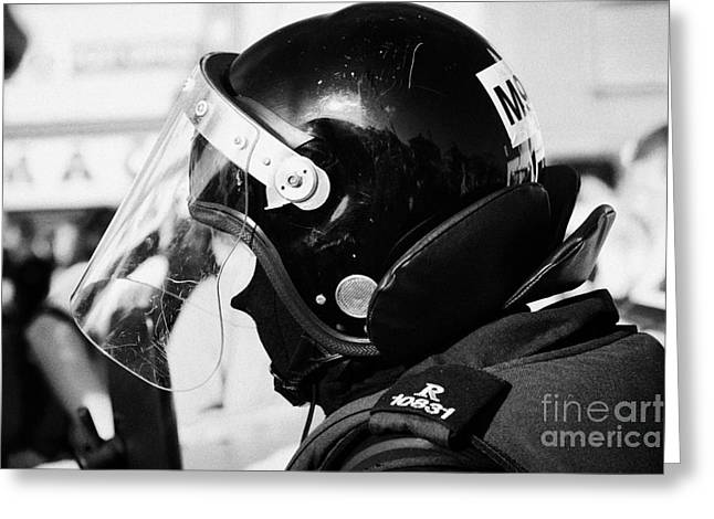 Protest Greeting Cards - Helmet of PSNI riot officer head and shoulders on crumlin road at ardoyne shops belfast 12th July Greeting Card by Joe Fox