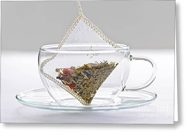 Organic Photographs Greeting Cards - Herbal tea bag in cup Greeting Card by Elena Elisseeva