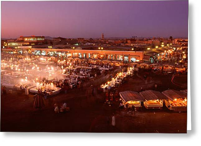 Town Square Greeting Cards - High Angle View Of A Market Lit Greeting Card by Panoramic Images
