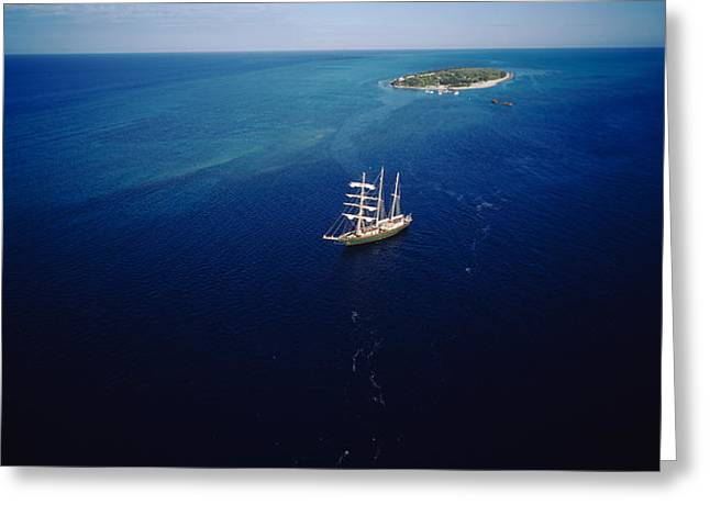Blue Sailboat Greeting Cards - High Angle View Of A Sailboat Greeting Card by Panoramic Images