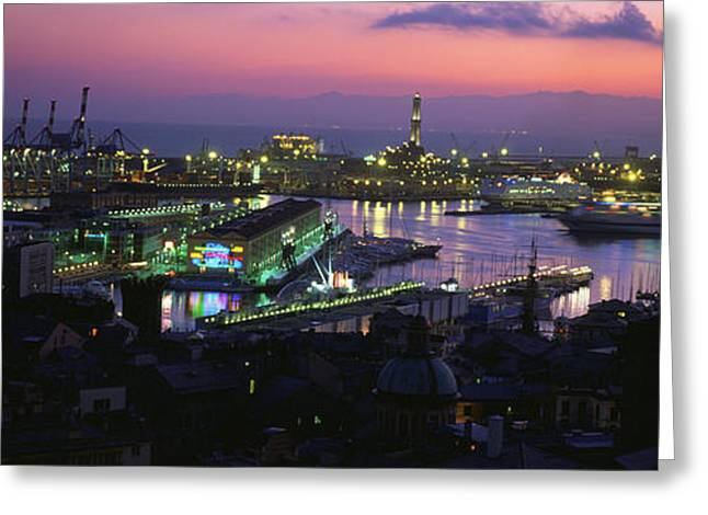 Commercial Photography Greeting Cards - High Angle View Of City At A Port Lit Greeting Card by Panoramic Images