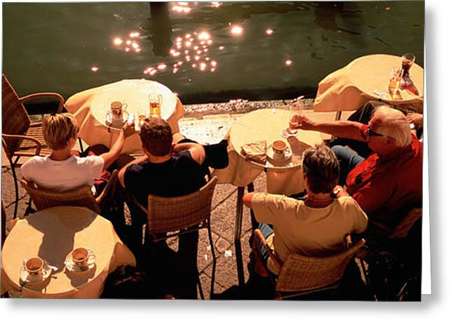 Reflections Of Shadows Greeting Cards - High Angle View Of Tourists Sitting Greeting Card by Panoramic Images