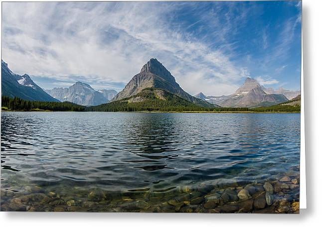 Reflection In Water Greeting Cards - High Clouds over Swiftcurrent Lake Greeting Card by Greg Nyquist