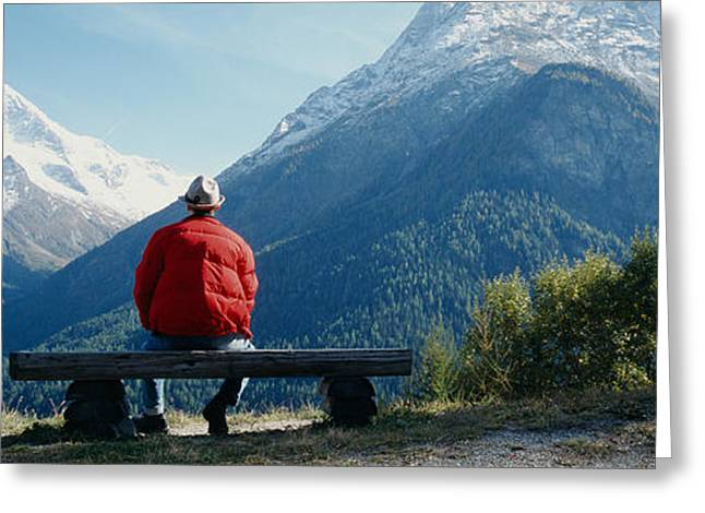 Height Greeting Cards - Hiker Contemplating Mountains Greeting Card by Panoramic Images