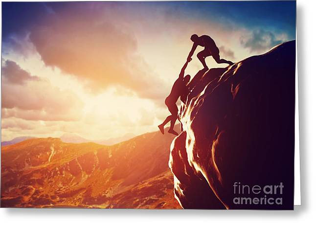 Ambition Photographs Greeting Cards - Hiker giving hand and helping in mountains Greeting Card by Michal Bednarek