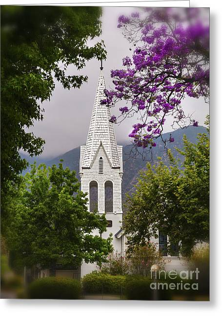 The Wooden Cross Greeting Cards - Historic Old White Wooden Church With Towering Steeple Among The Trees Greeting Card by Jerry Cowart