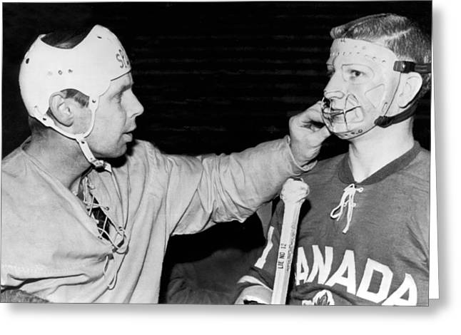 Professional Ice Hockey Greeting Cards - Hockey Goalie Inspects Mask Greeting Card by Underwood Archives