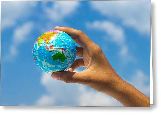 Planet Earth Photographs Greeting Cards - Holding a globe Greeting Card by Aged Pixel