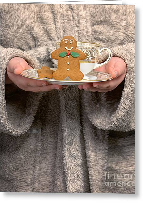 Bathrobe Greeting Cards - Holding Gingerbread Biscuits Greeting Card by Amanda And Christopher Elwell